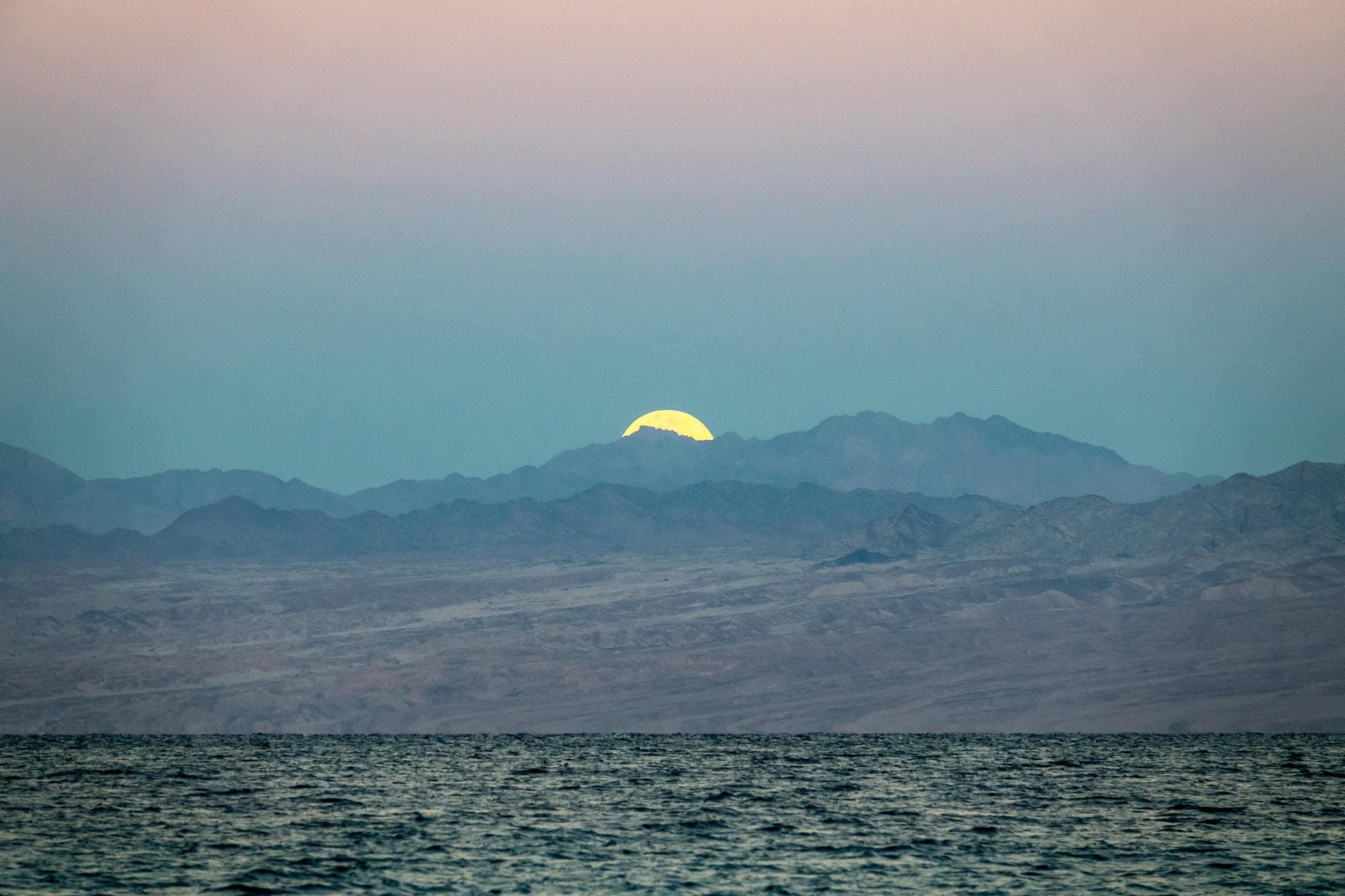 The Supermoon setting over Saudi Arabia, as seen from the Sinai peninsula in egypt