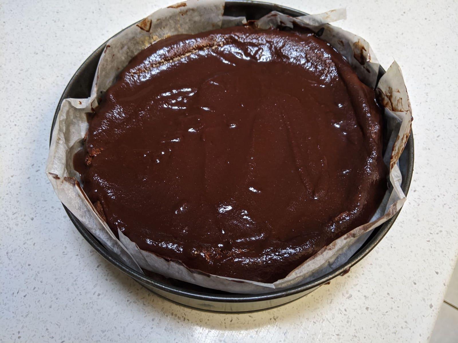 Tartine chocolate soufflé cake with ganache poured over it